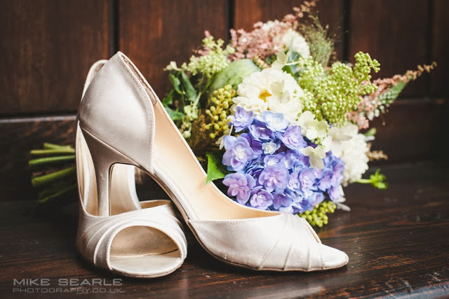 Fine art reportage wedding photograph of the bride's shoes