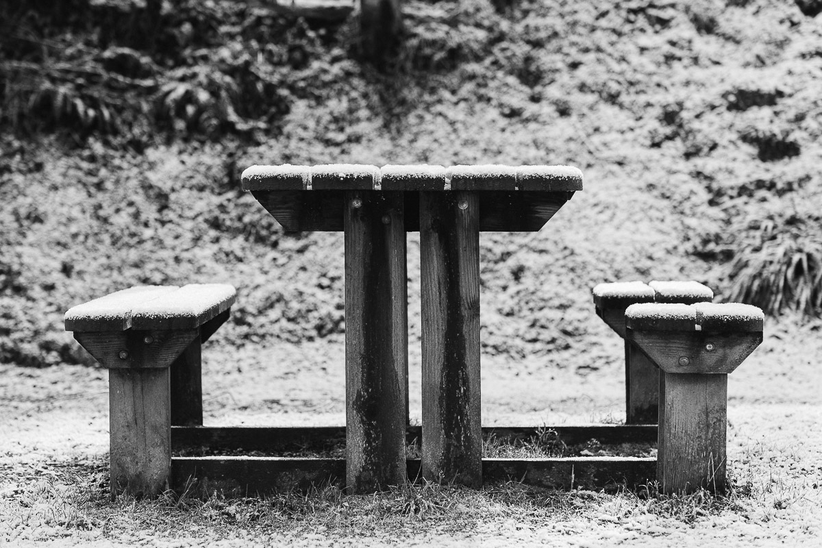 Picnic bench in snow in Cornwall