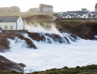 Storm surf in Newquay at high tide